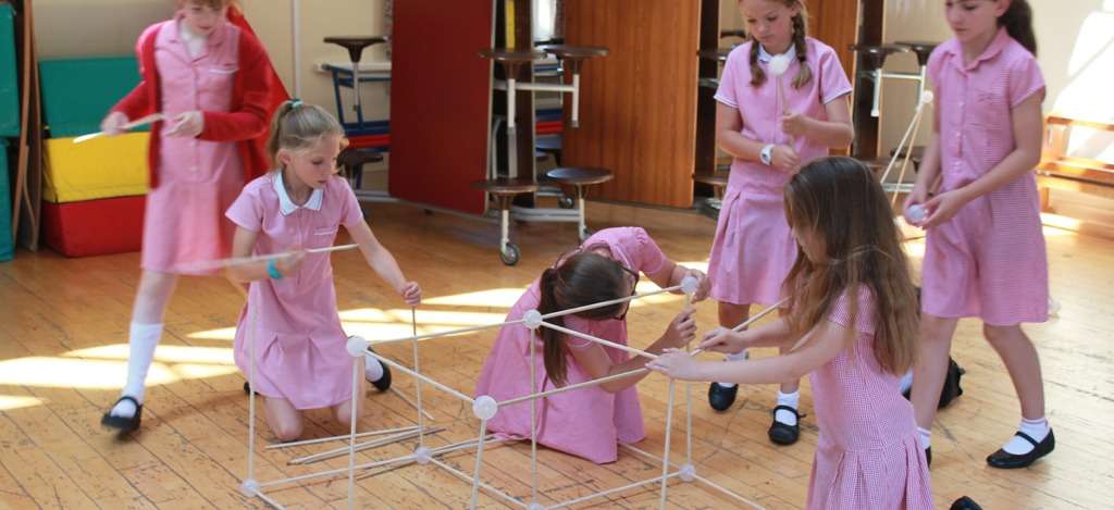 Pupils working together to build a cube