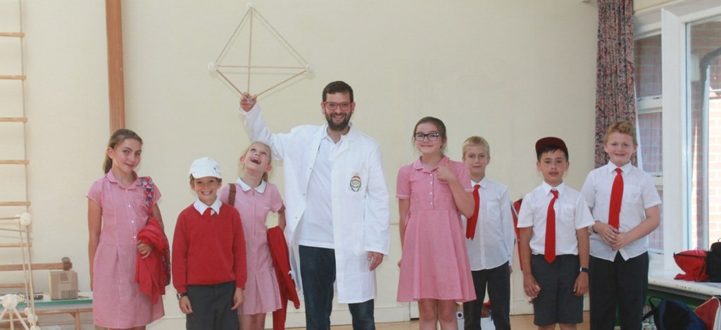 Professor Brainwave holding a tetrahedron with pupils